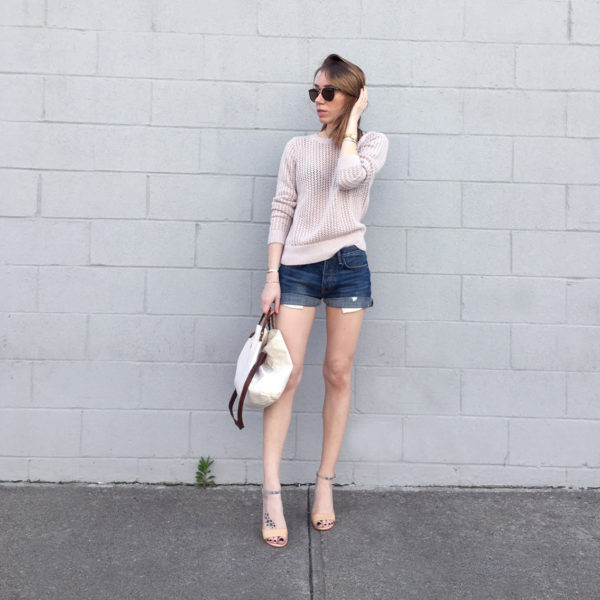 Pink sweater with denim shorts outfit