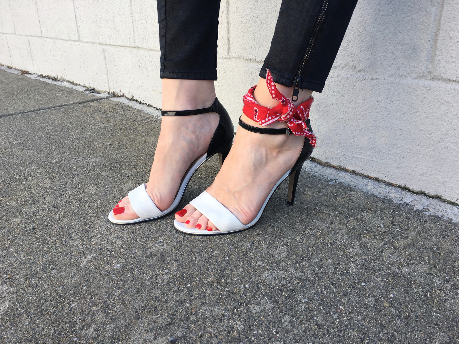 Closeup black and white heels with red bandana