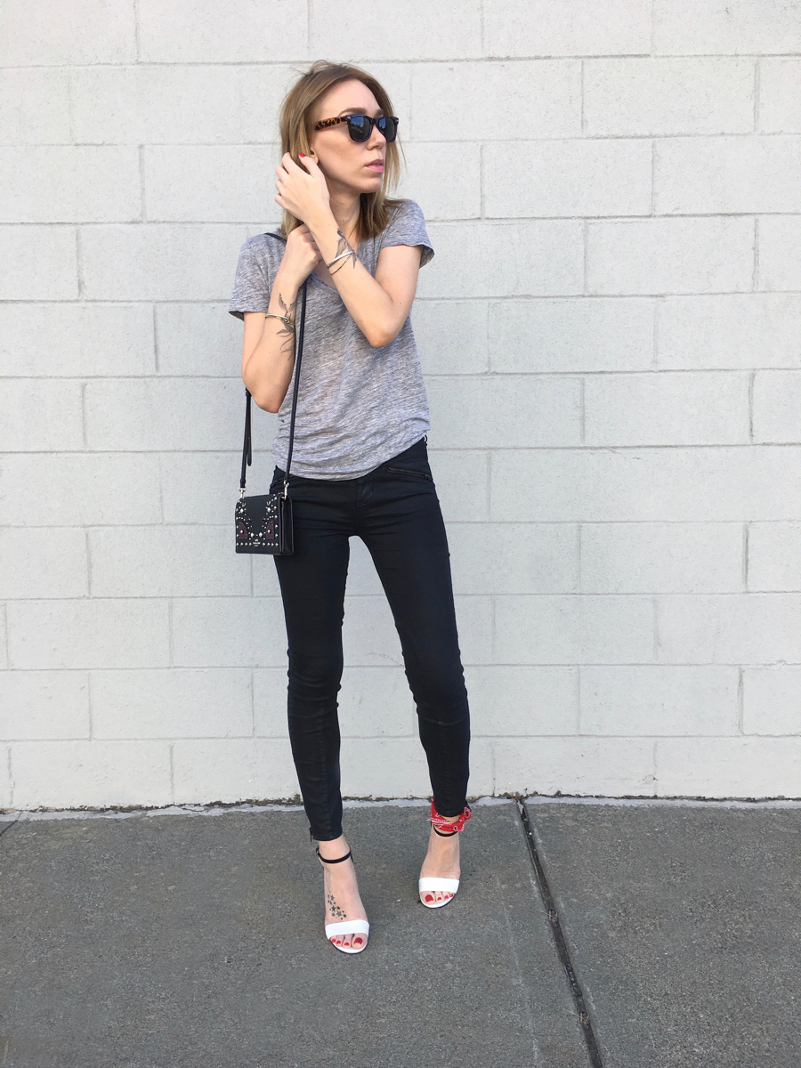 Black jeans with grey shirt and heels outfit