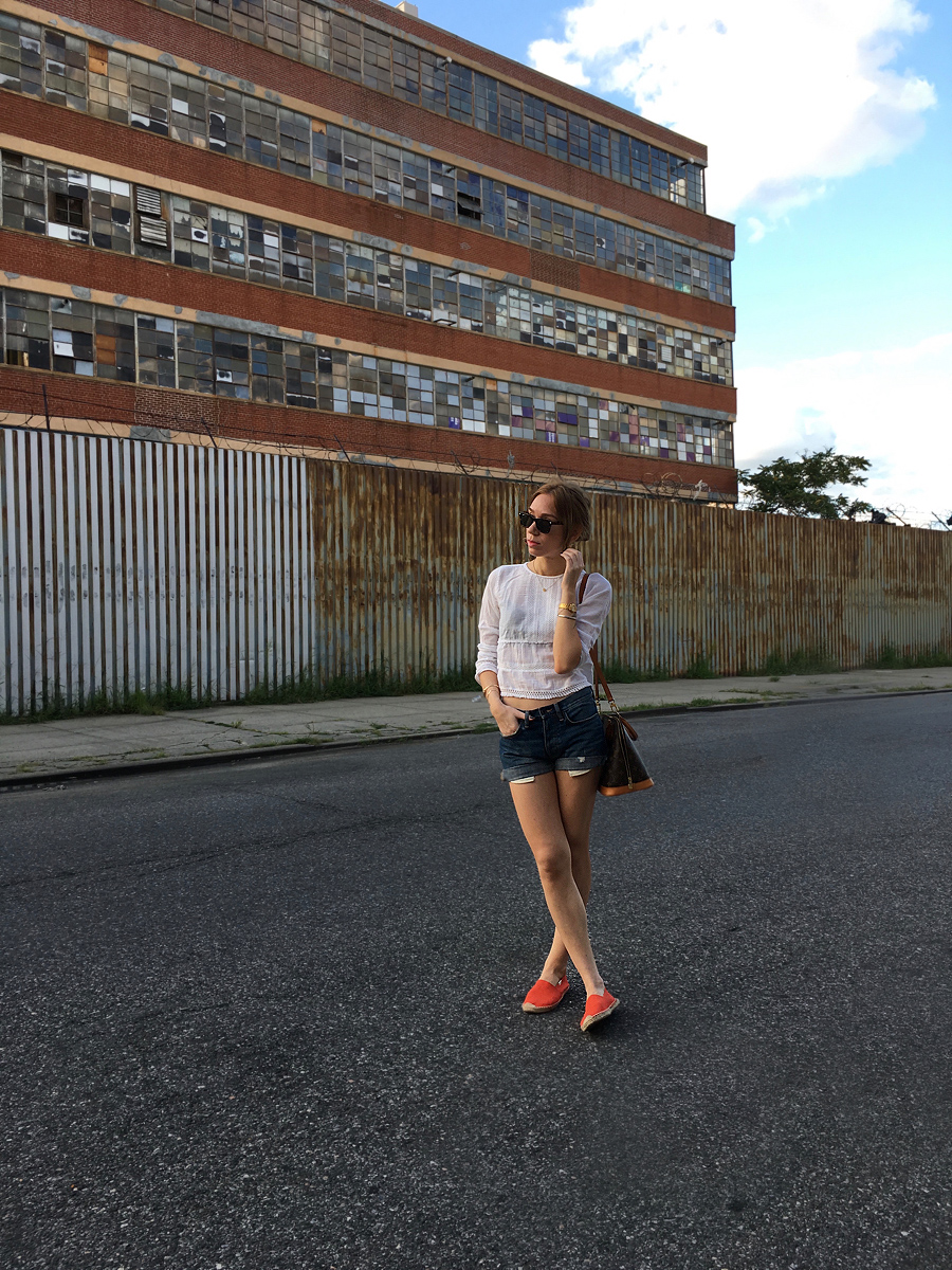 Red Soludos outfit with denim shorts and a white top