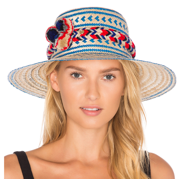 Blue and cream straw hat with colorful pom poms