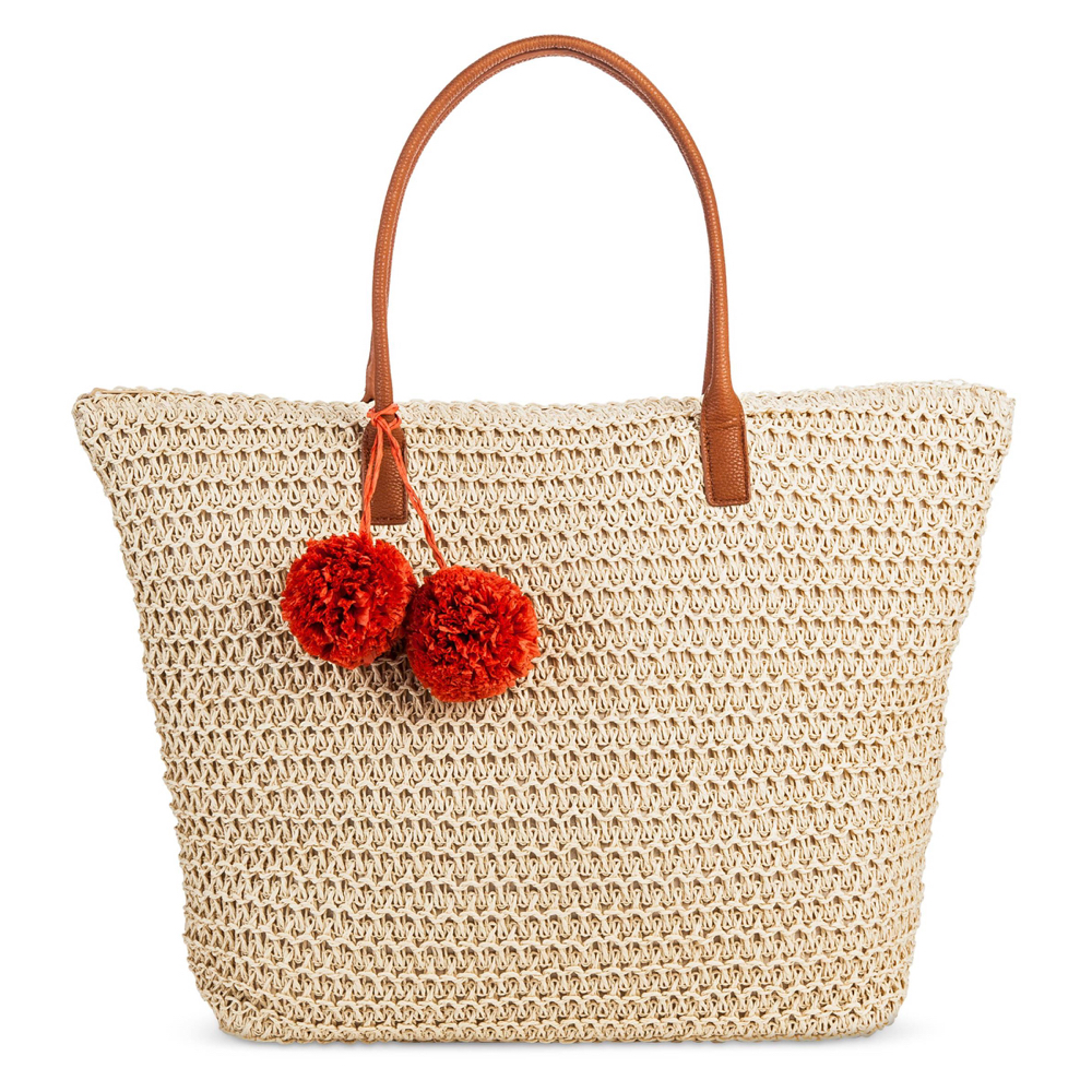 straw tote bag in natural with red pom poms