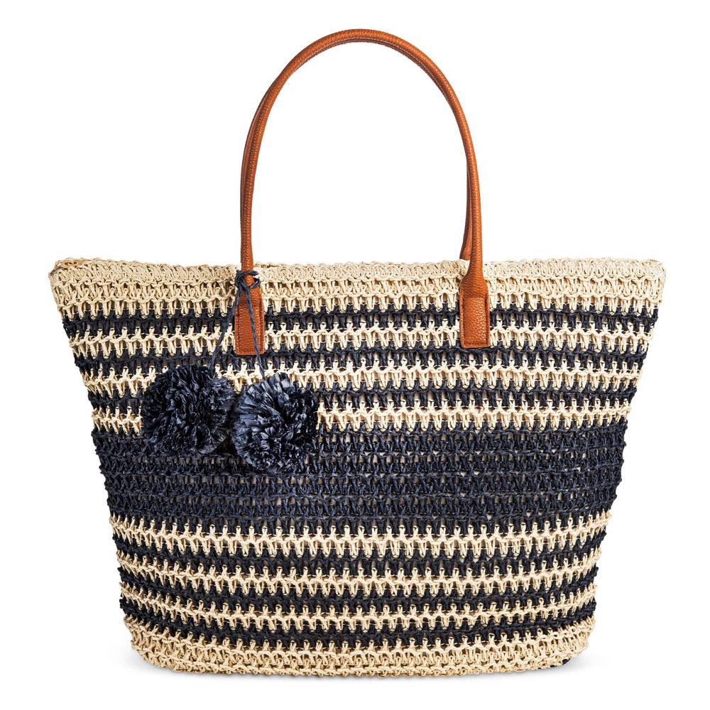 Target straw bag in navy with cream stripes and navy pom poms