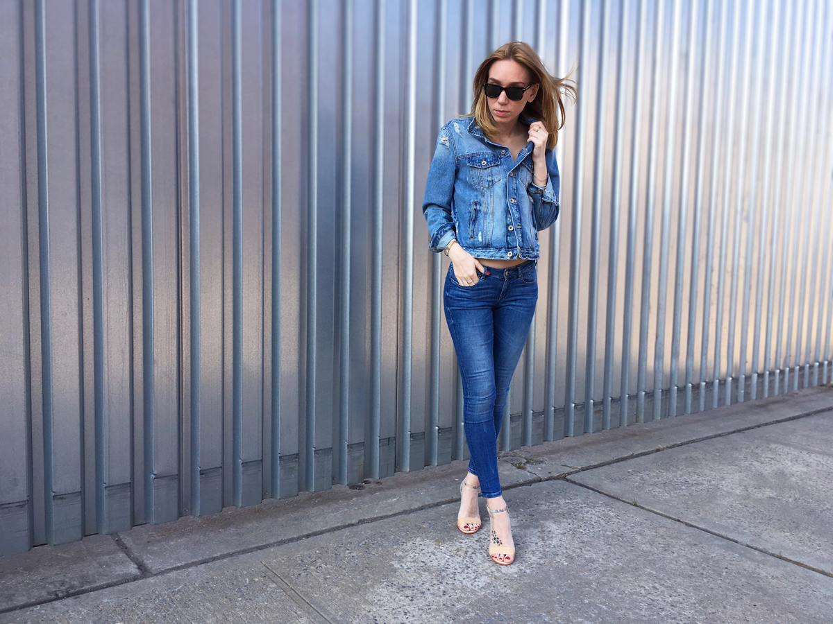 Girl wearing denim jacket and jeans outfit posing