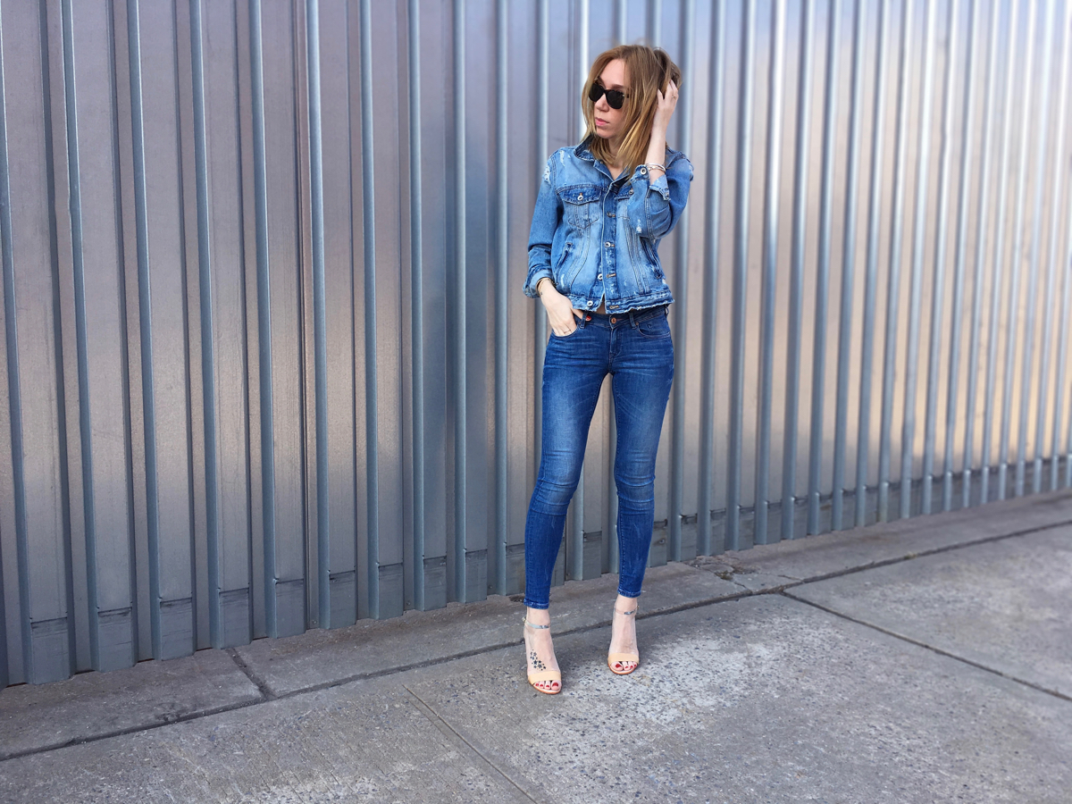 Girl wearing denim jacket and denim jeans outfit posing outside