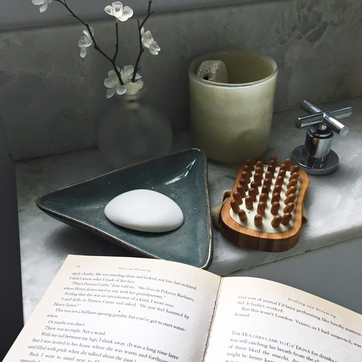 Bathtub with a bar of soap and a book