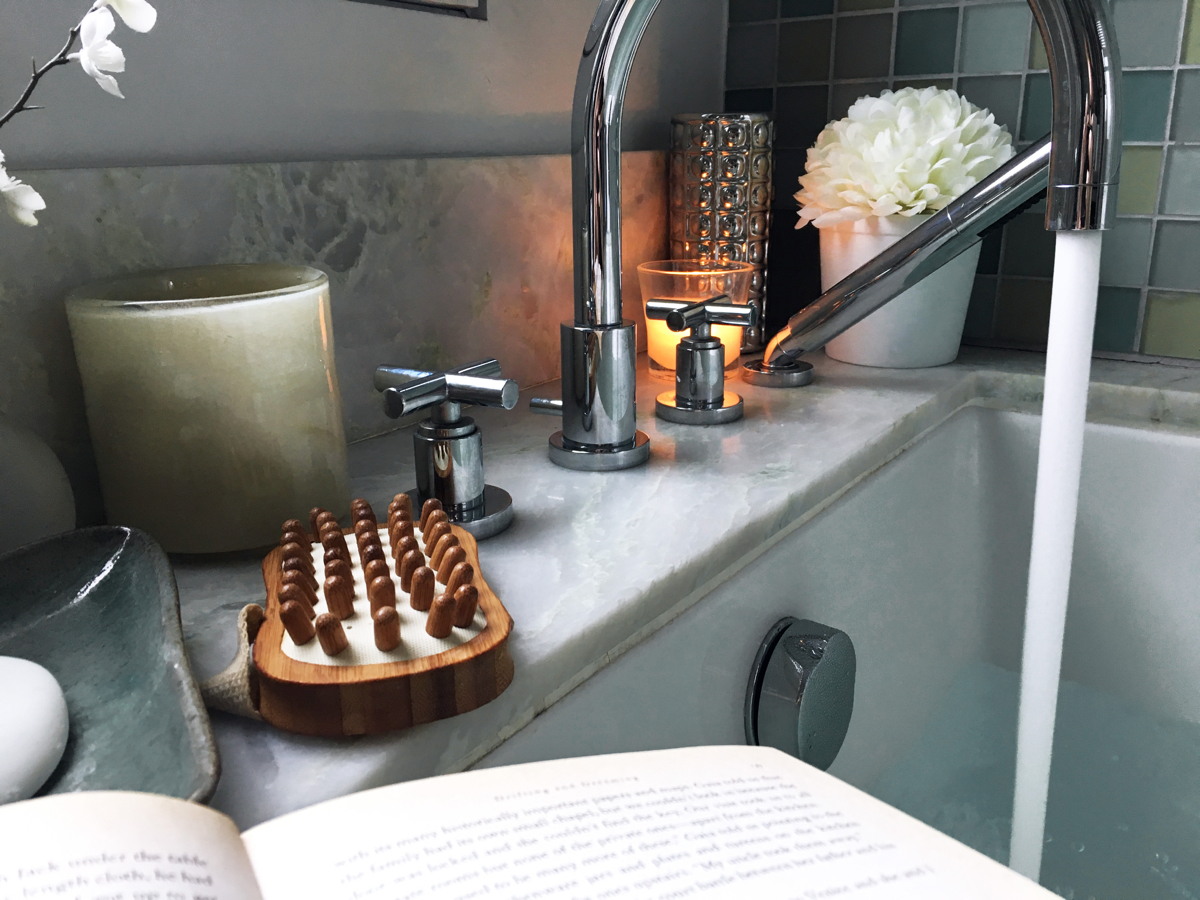 Bathtub with running water and a book