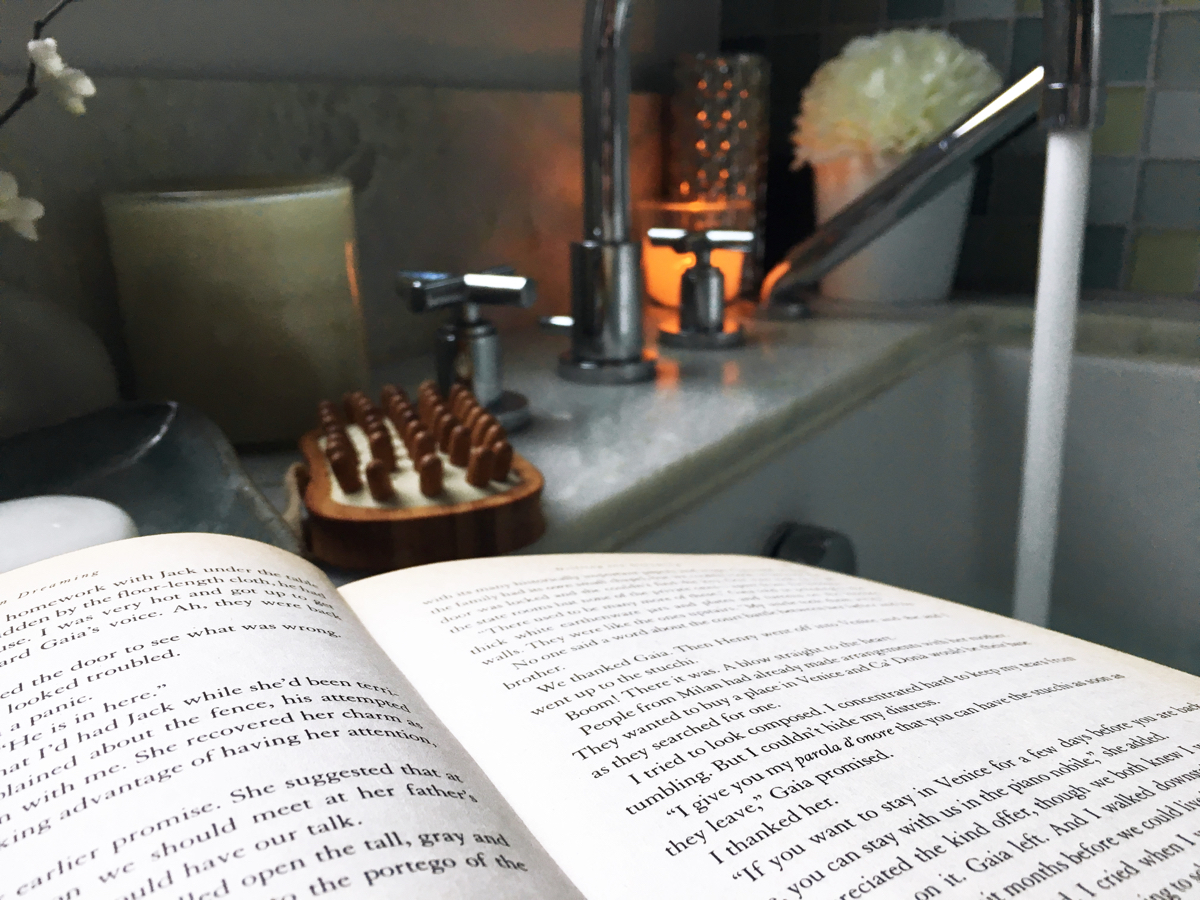 Book with bathtub in the background