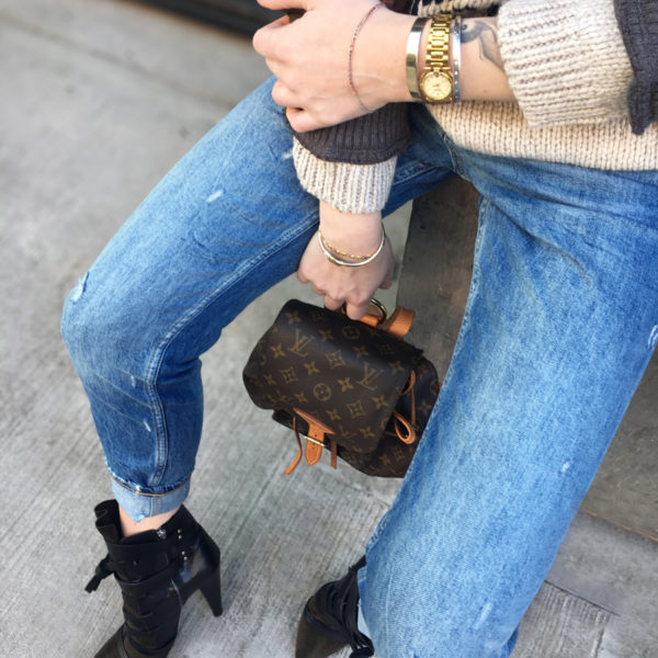 Detail shot of jeans with heels and Louis Vuitton bag
