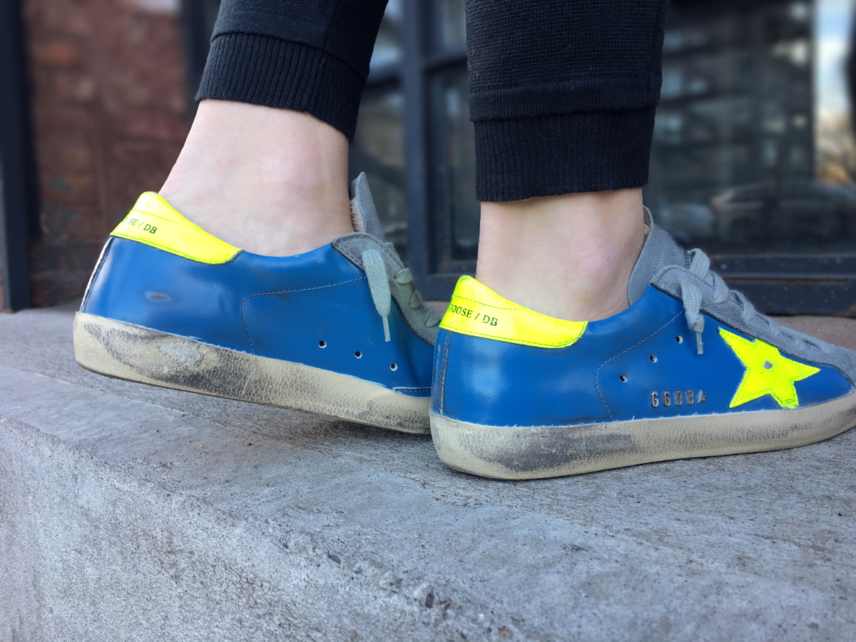 Detail shot of blue and neon green Golden Goose sneakers