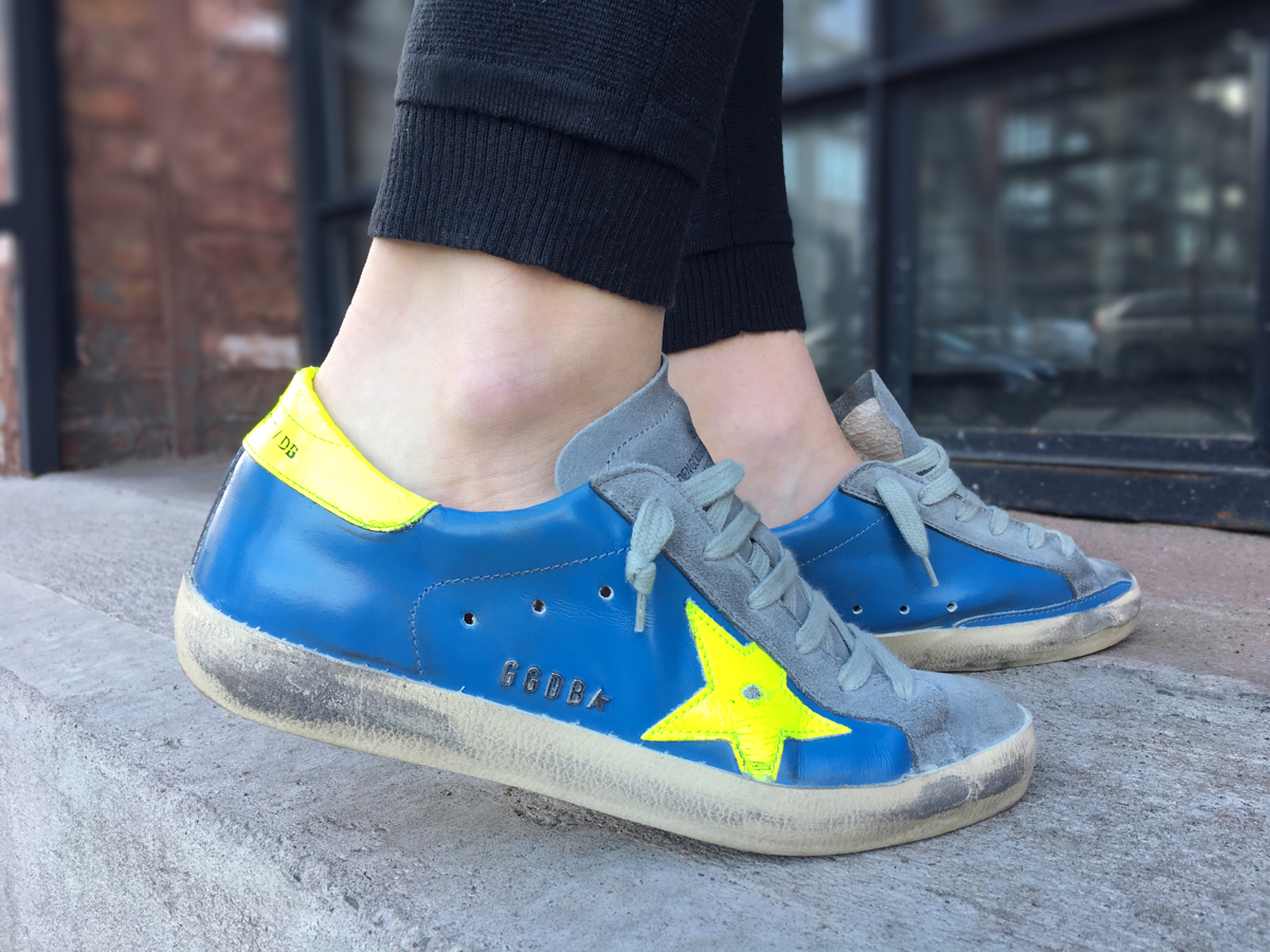 Close up shoe of neon green and blue Golden Goose sneakers