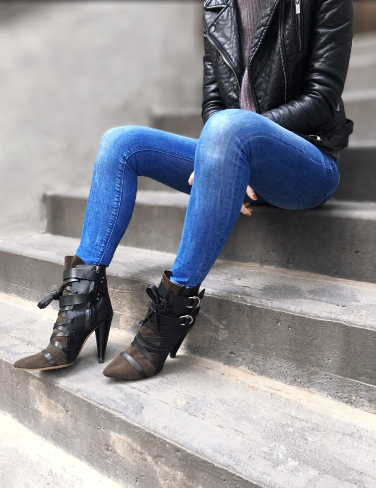 zoomed in shot of jeans and leather heels