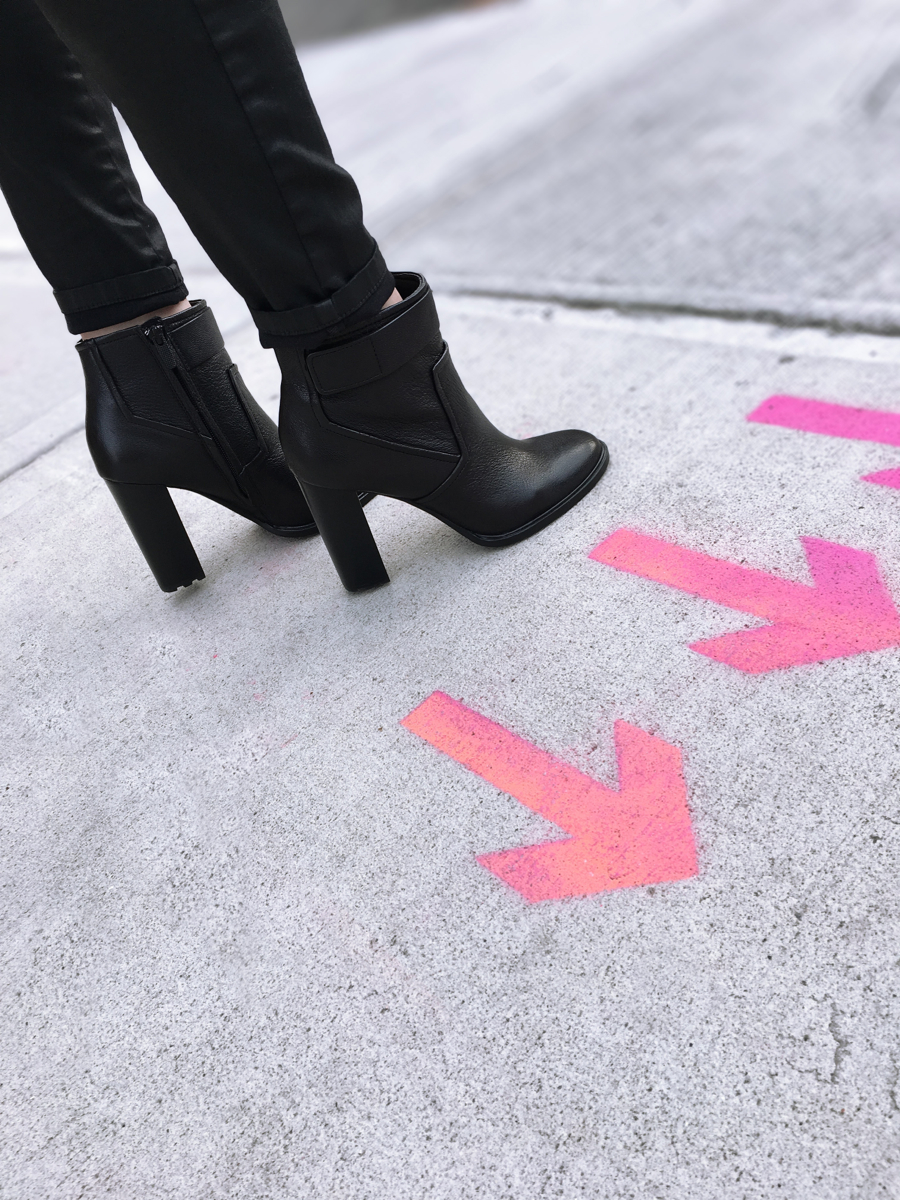 Detail shot of black leather heeled booties