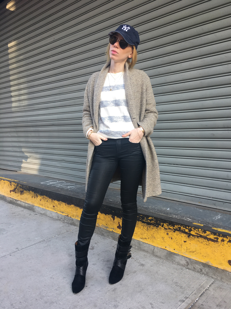 Woman posing wearing beige coat with black jeans