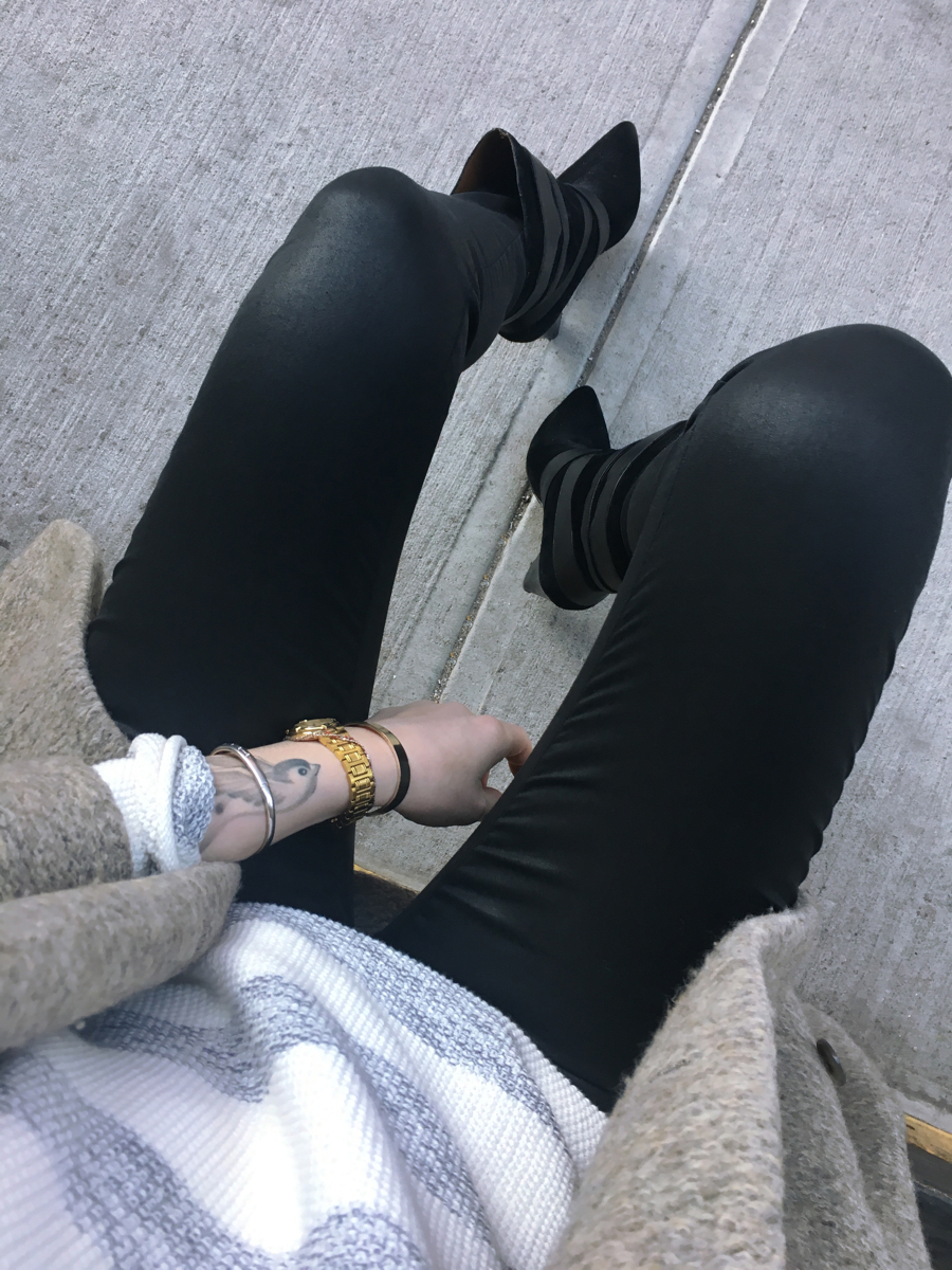 Detail shot of black jeans and striped sweater