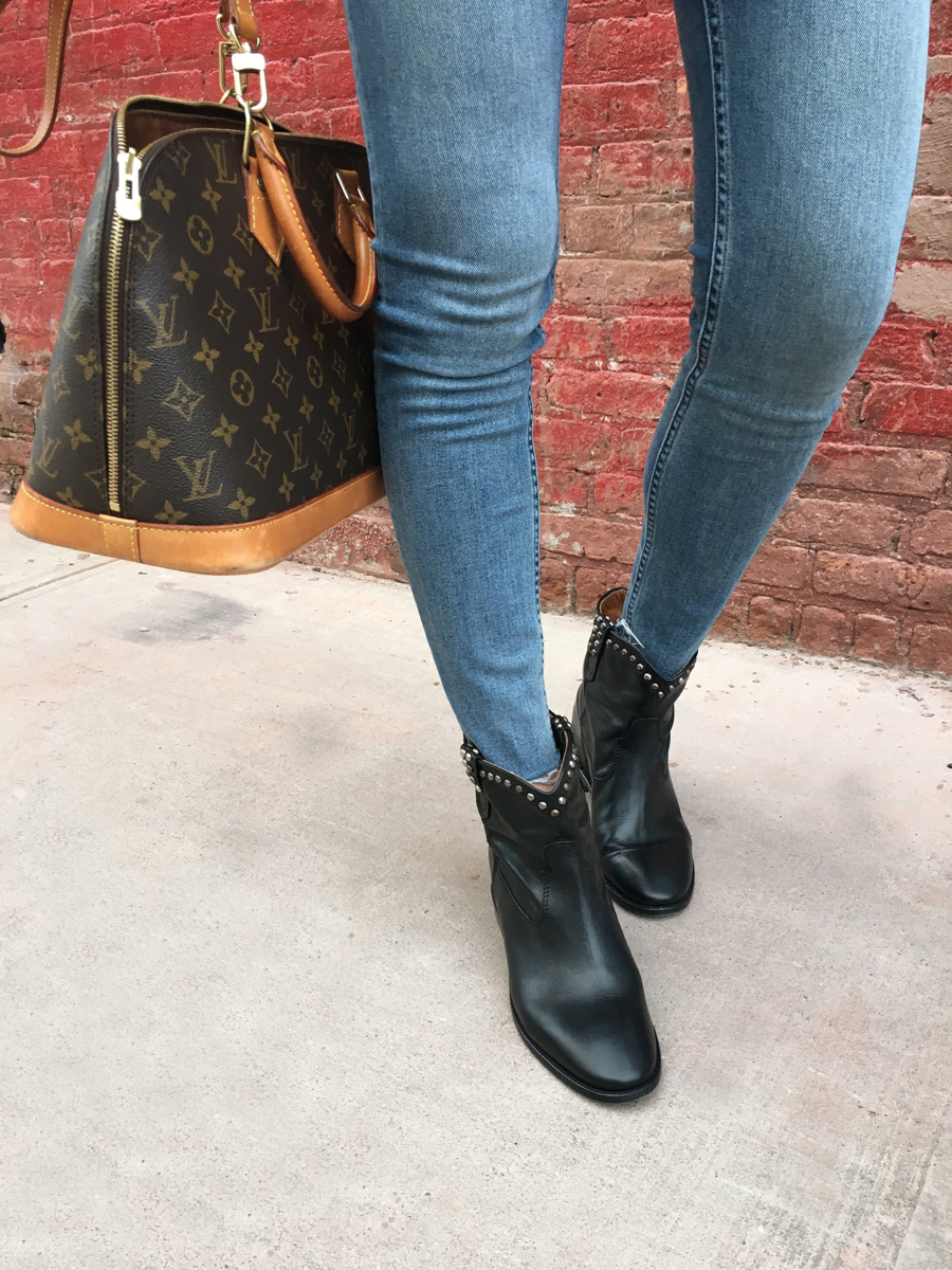 Detail shot of jeans, boots, and bag
