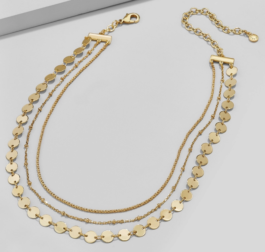 Gold necklace with three chains