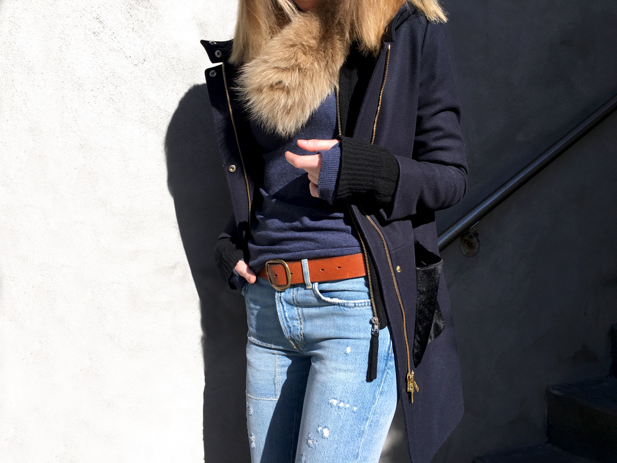 Detail shot of navy outfit with fur vest