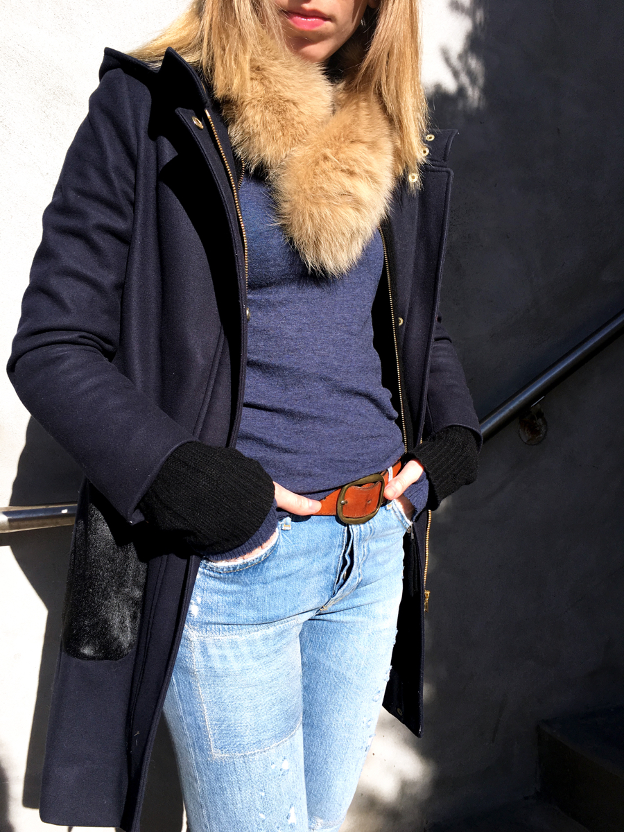 Detail shot of navy jacket with fur scarf